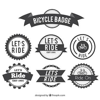 Jogo dos emblemas retro bicicleta Vetor grátis