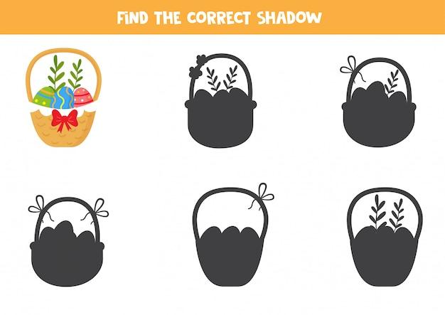Jogo educativo para crianças. encontre a sombra certa da cesta de páscoa.