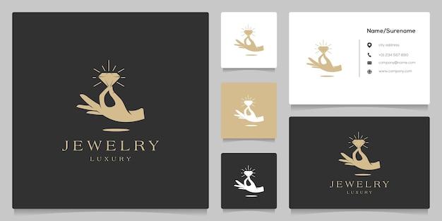 Joias de diamante na mão ilustração de design de logotipo de luxo com cartão de visita