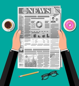 Jornal com donut, xícara de café, lápis. elementos de negócios de manhã, café da manhã, coffee break.