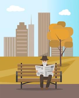Jornal de leitura de parque outono e homem idoso