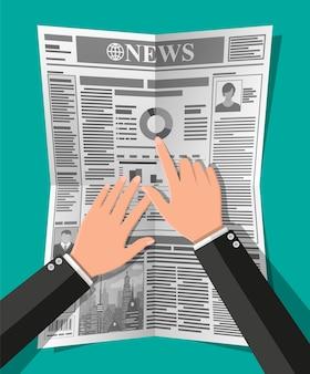 Jornal diário em mãos