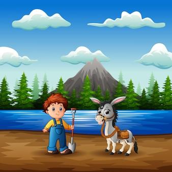 Jovem agricultor com uma cabra no rio