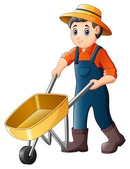 Jovem agricultor dos desenhos animados, empurrando um carrinho de mão