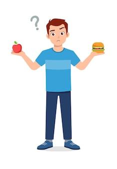 Jovem bonito escolhe comida saudável ou junk food
