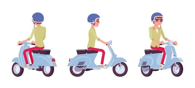 Jovem bonito, montando uma scooter