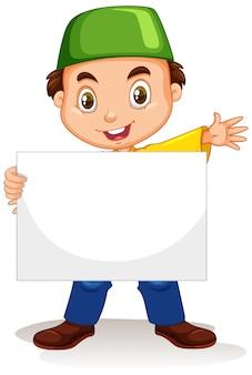 Jovem bonito personagem de desenho animado segurando um cartaz em branco
