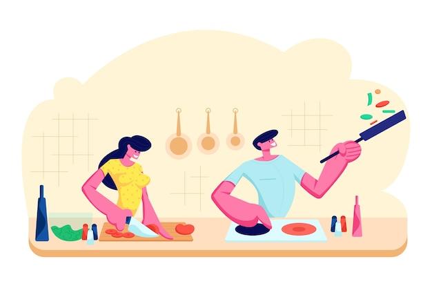 Jovem casal apaixonado cozinhando juntos na cozinha. família prepara o jantar com produtos frescos na mesa