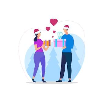 Jovem casal apaixonado em chapéus sanata fazendo presentes