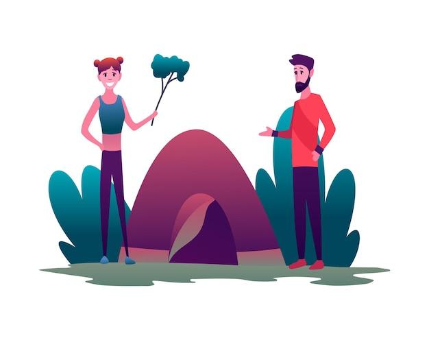 Jovem casal caminhando com barraca