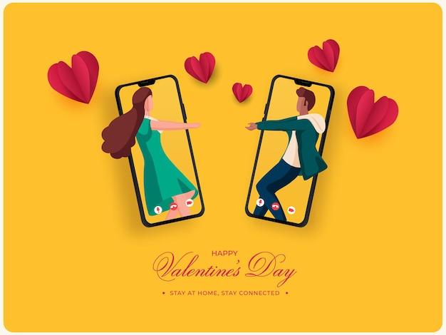 Jovem casal dançando ou interagindo através de videochamada com corações de papel para feliz dia dos namorados, fique em casa.