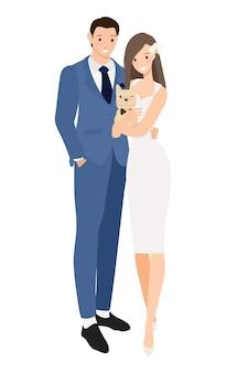 Jovem casal de noivos fofo com cachorro bulldog francês em sua fantasia de casamento, isolado no fundo branco