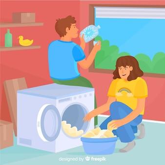 Jovem casal fazendo trabalhos domésticos juntos
