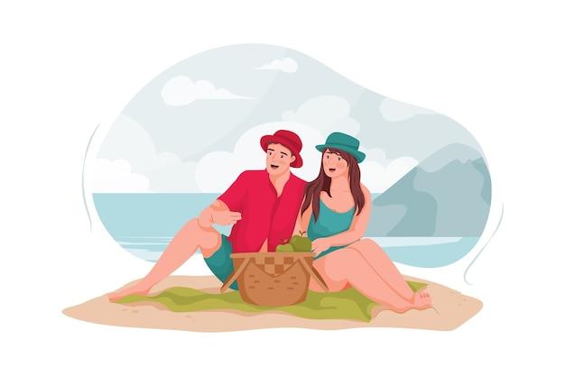 Jovem casal fazendo um piquenique na praia.