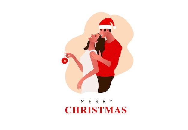 Jovem casal lindo comemorando o natal. menina segura bugiganga de natal. chapéu de natal, presentes,
