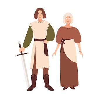 Jovem casal vestido com roupas da idade média.