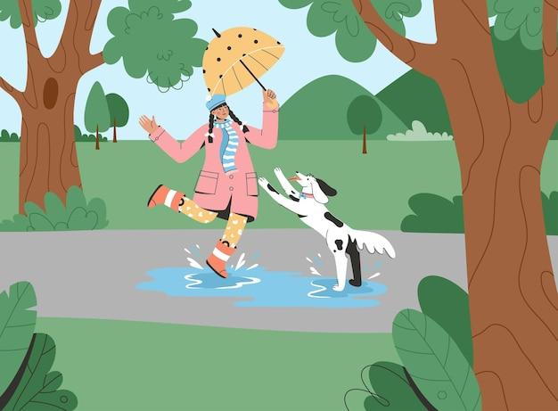 Jovem com guarda-chuva caminhando com cachorro no parque