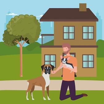 Jovem com mascote de cães fofos na casa ao ar livre
