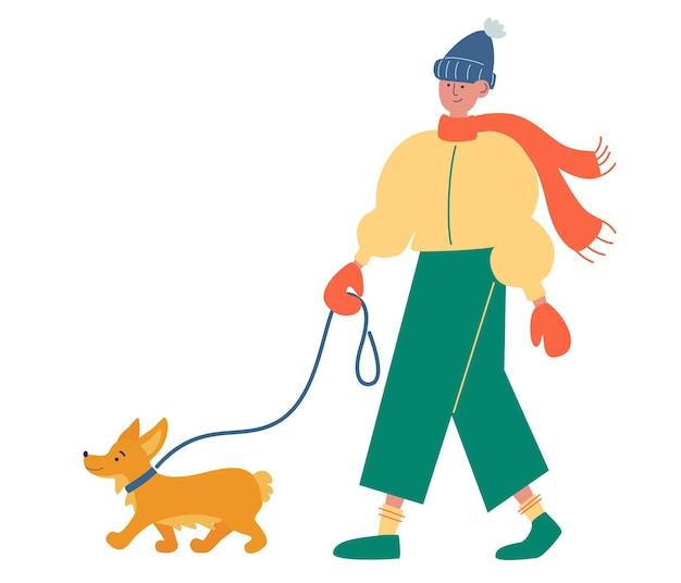 Jovem com roupas elegantes de inverno caminhando com um cachorro melhores amigos humanos estilo de vida saudável