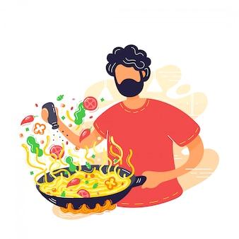 Jovem coocking macarrão na frigideira wok