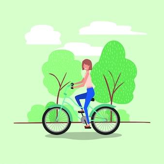 Jovem de bicicleta no parque