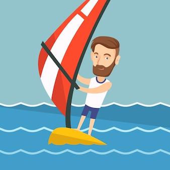 Jovem de windsurf no mar.