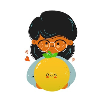 Jovem e fofa garota engraçada segurando uma toranja