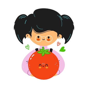 Jovem e fofa garotinha engraçada segurando o tomate na mão