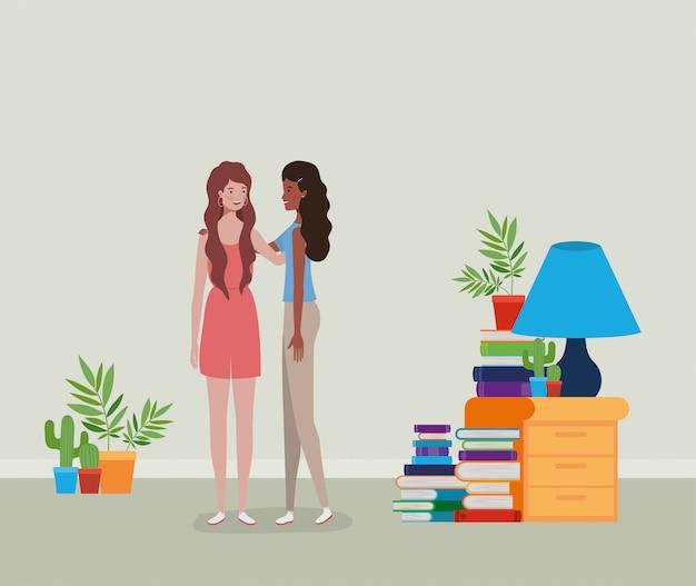 Jovem e linda meninas interraciais casal na casa