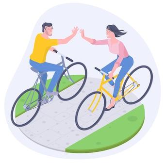 Jovem e mulher andando de bicicleta na estrada ensolarada de verão rural e dando mais cinco mãos. plano