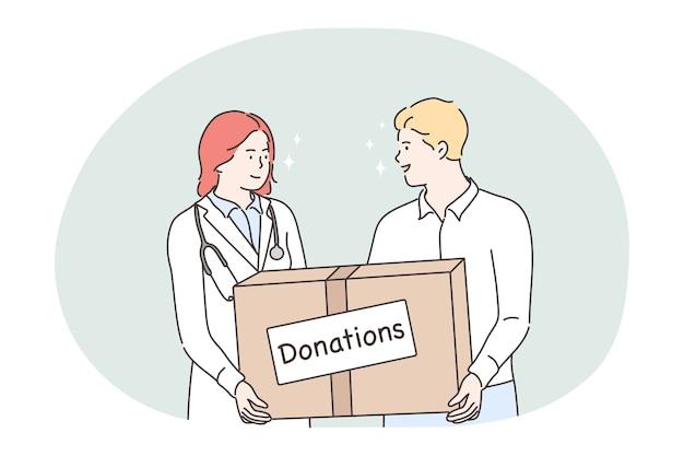 Jovem e mulher médico voluntários segurando uma caixa com tratamento de doações.