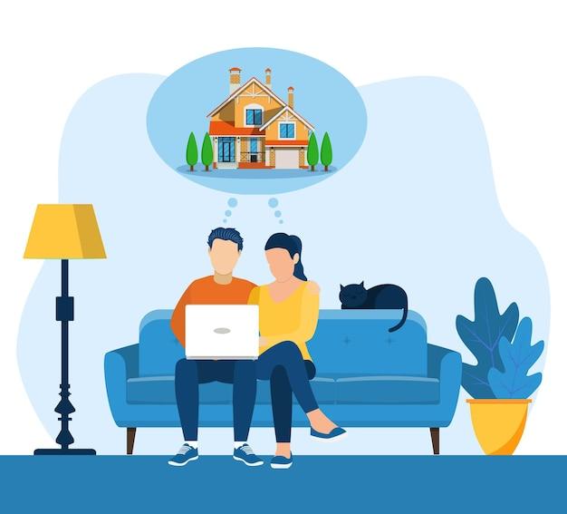 Jovem e mulher usando um laptop