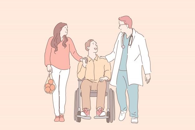 Jovem em cadeira de rodas com sua esposa conversando com fisioterapeuta.