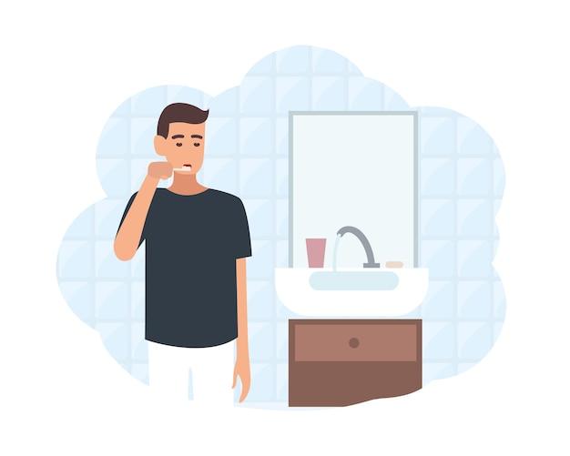 Jovem em frente ao espelho no banheiro, escovando os dentes com uma escova de dentes