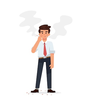 Jovem empresário está de pé e fumando cigarro