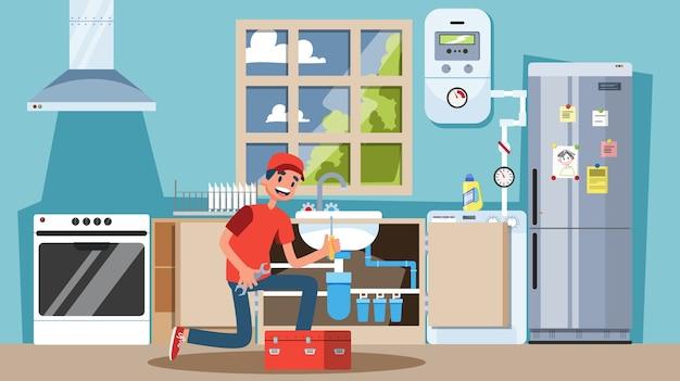 Jovem encanador uniformizado conserta tubos na cozinha