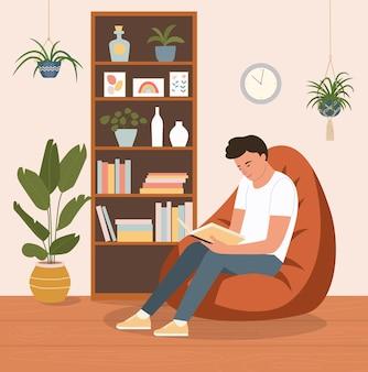 Jovem está relaxando na confortável pufe e lendo o livro. ilustração em vetor plana dos desenhos animados