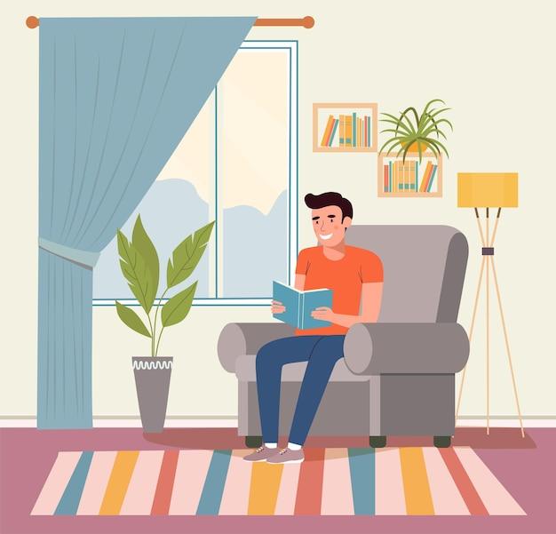 Jovem feliz está relaxando na cadeira confortável e lendo o livro.