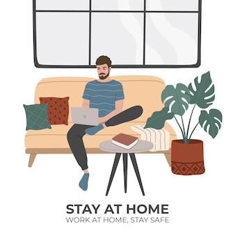 Jovem fica em casa, trabalhando no laptop, sentado em um sofá confortável