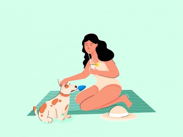 Jovem garota bebendo suco de limão com animal cachorro na esteira verde ou folha.