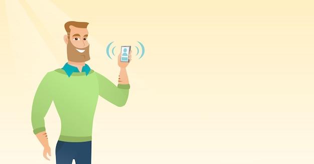 Jovem homem caucasiano segurando toque celular