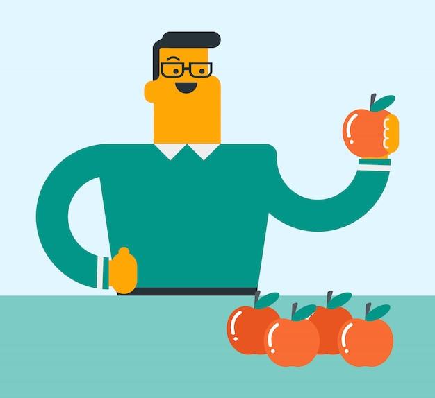 Jovem homem caucasiano segurando uma maçã.
