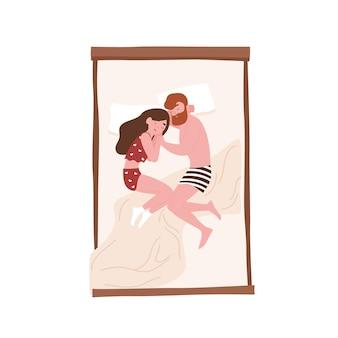Jovem homem e mulher deitados frente a frente na cama e dormindo em posição fetal