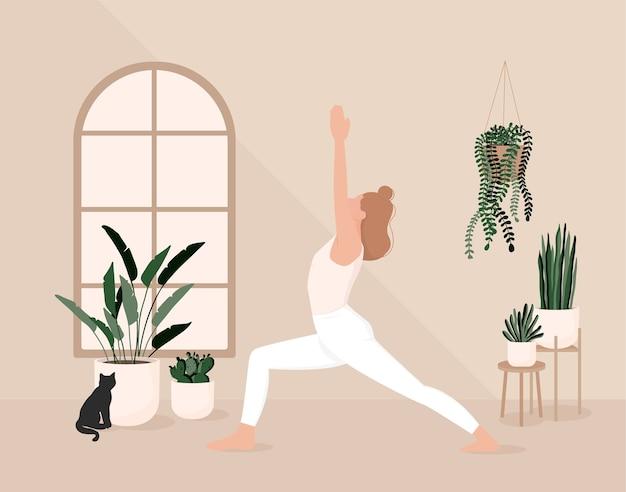 Jovem linda esbelta pratica ioga em casa na sala de estar durante a quarentena.