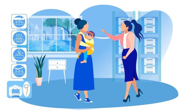 Jovem mãe com bebê sling escolhendo colchão