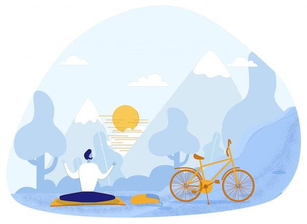 Jovem meditando na bicicleta a pé no parque verde