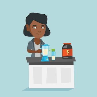 Jovem mulher africana fazendo cocktail de proteína.