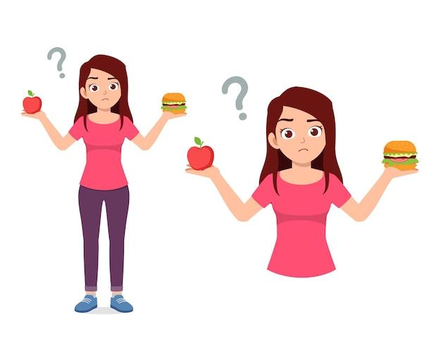 Jovem mulher bonita escolhe comida saudável ou junk food