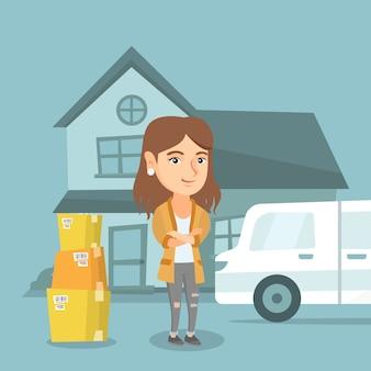 Jovem mulher caucasiana, movendo-se para uma casa nova.