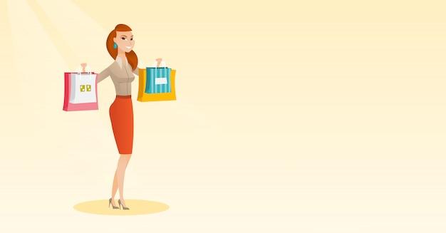 Jovem mulher caucasiana segurando sacolas de compras.